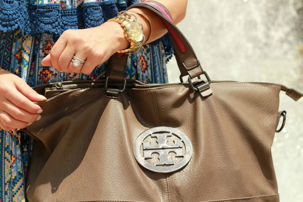 Oversized handbag and gold accessories