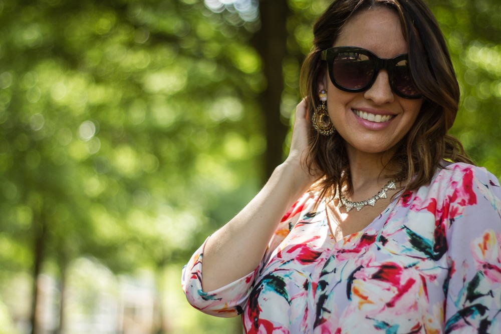 Loose brunette waves, Lisi Lerch earrings, and sunnies