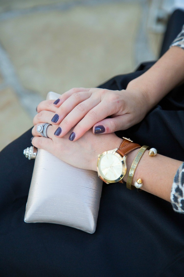 Bedazzled clutch, gold arm stack, and fall nails