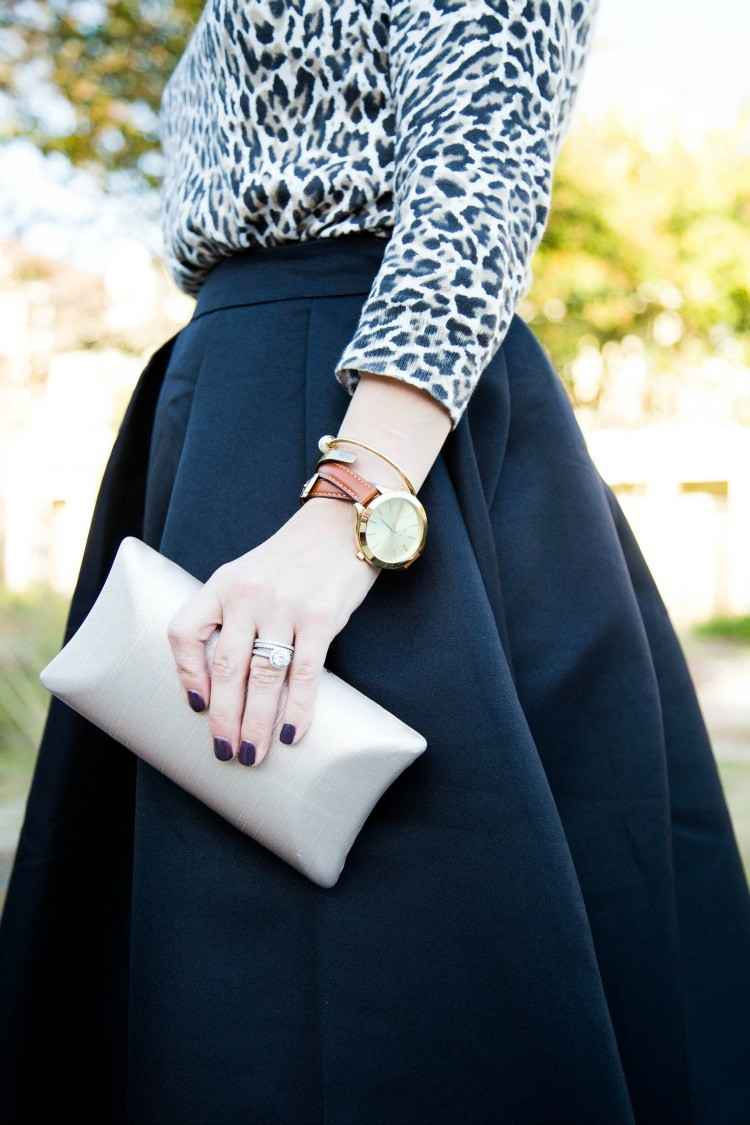 Leopard, a midi skirt, and champagne colored clutch