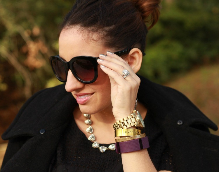 Sunnies, top knot, skinnies, and arm candy