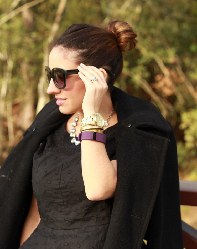 Top knot, sunnies, and arm candy