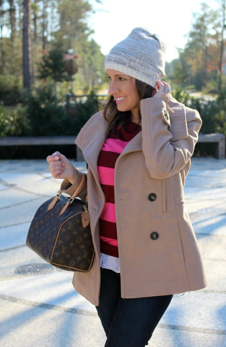 Striped red and pink sweater, and Camel coat