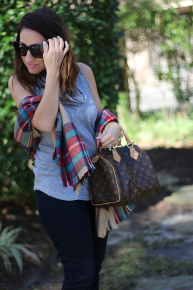 Sunnies, red plaid scarf, and cowl neck top