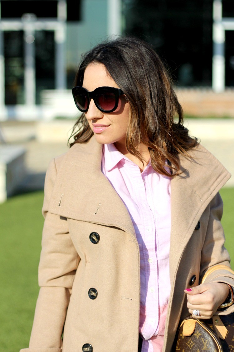 Black sunnies and a pink collared shirt