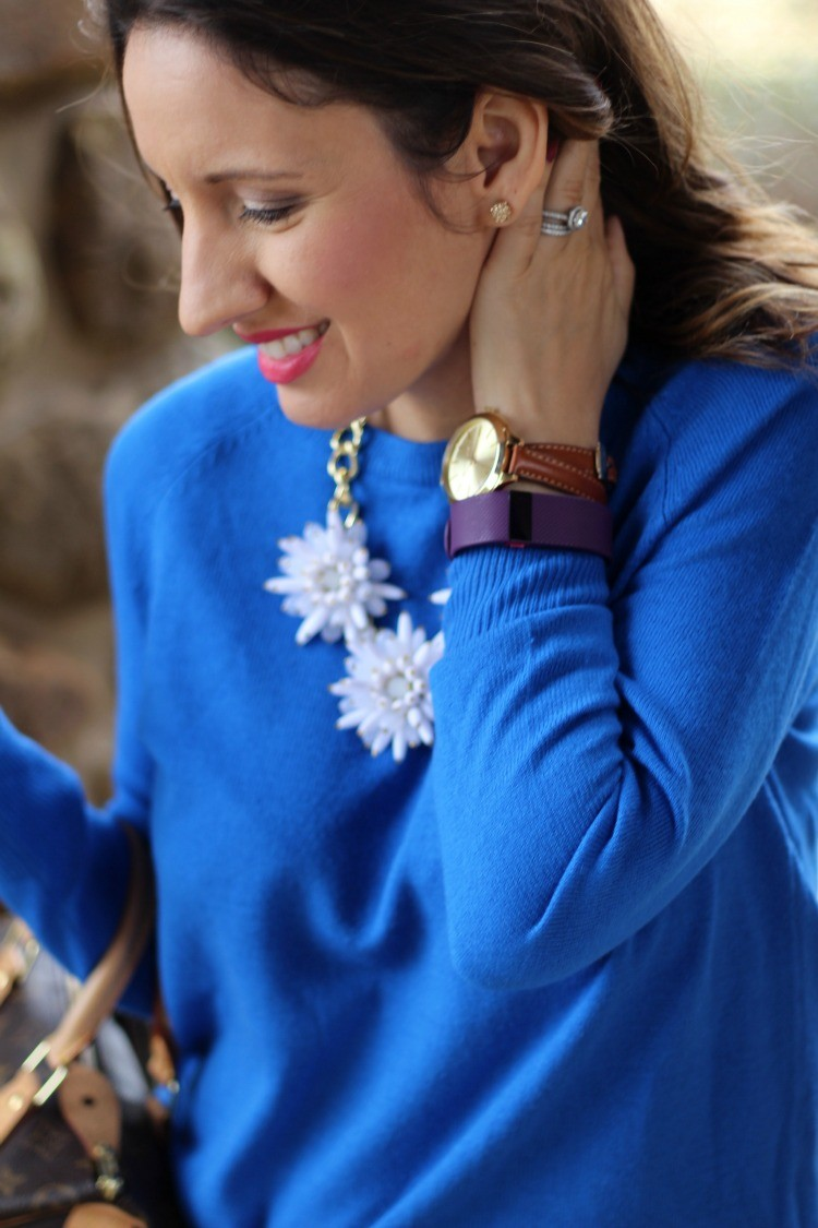 White statement necklace, and brown Michael Kors watch