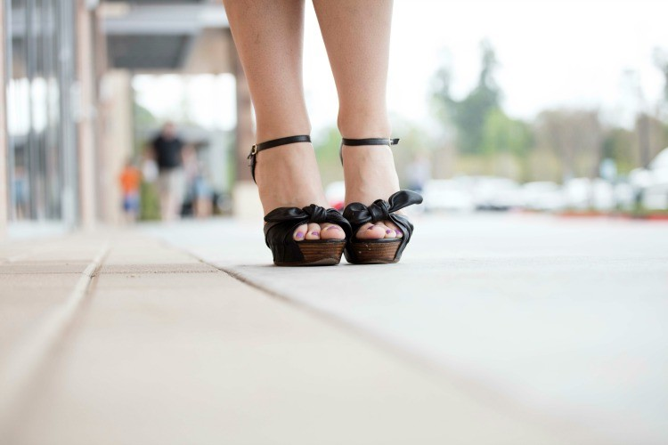 Black wedges and a purple pedicure