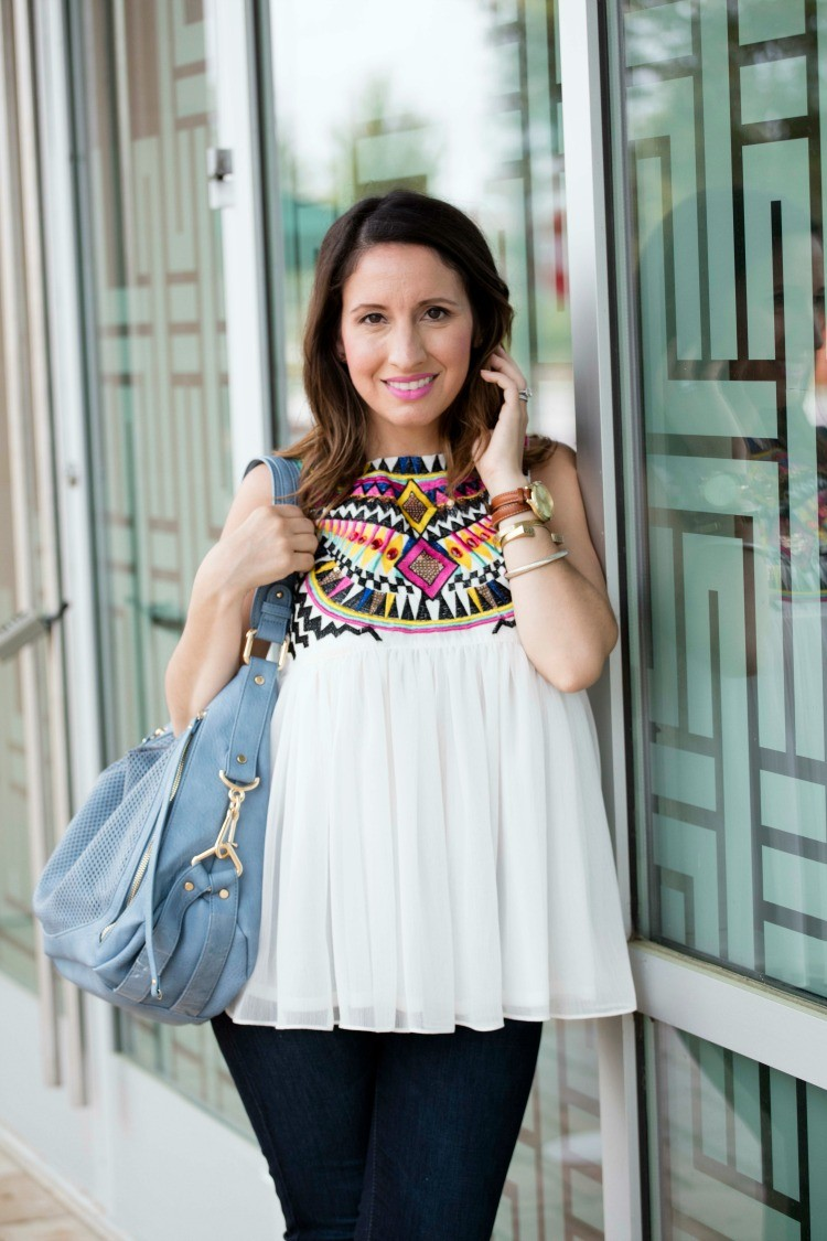 White Sleeveless Embroidery Pleated Chiffon top, skinny jeans, and black wedges