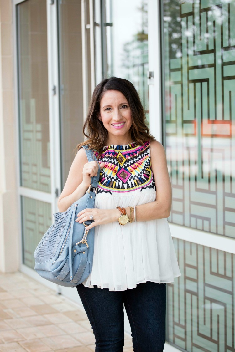Bright argyle top, skinny jeans, and blue must have bag