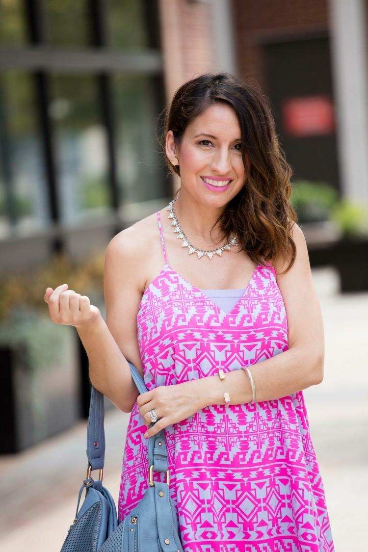 Bright pink dress, purple bando top, and light blue bag