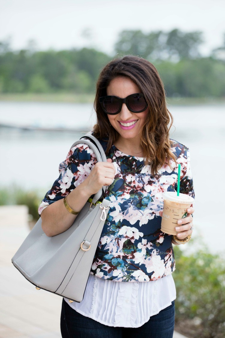 Navy floral crop top layered with a white blouse and Starbucks of course