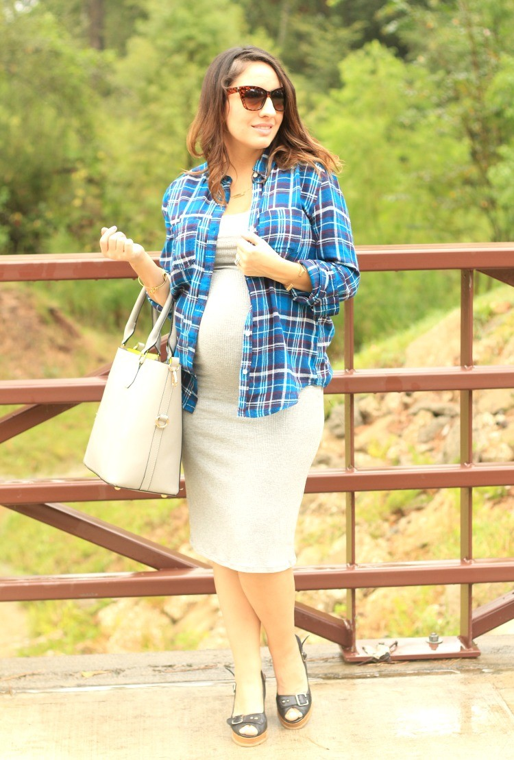 Blue plaid shirt, grey body con dress, and black wedges