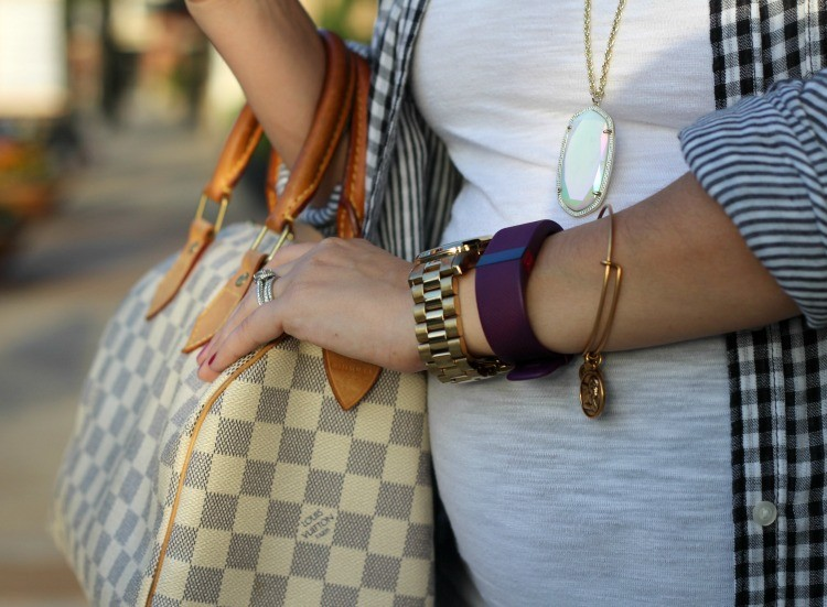 Gold accessories and a Louis Vuitton Speedy Handbag