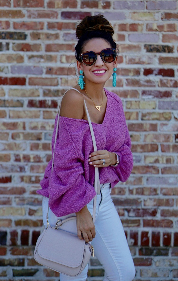 Big tortious shell sunglasses, Orchid colored drop shoulder slouchy sweater, and white denim
