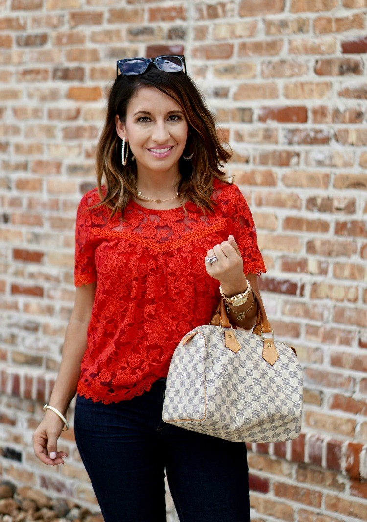 Red lace inset top, skinny jeans, and Stella and Ruby pearl hoops