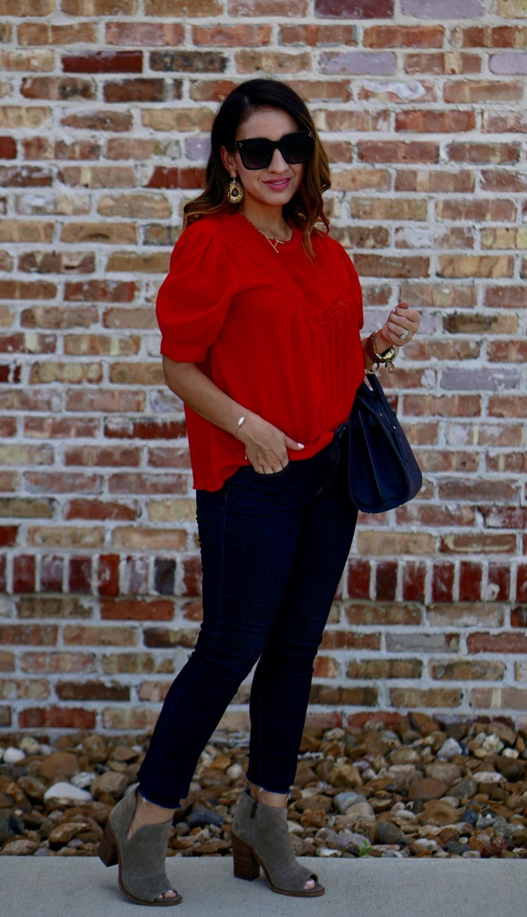 Red top, skinny jeans, and booties