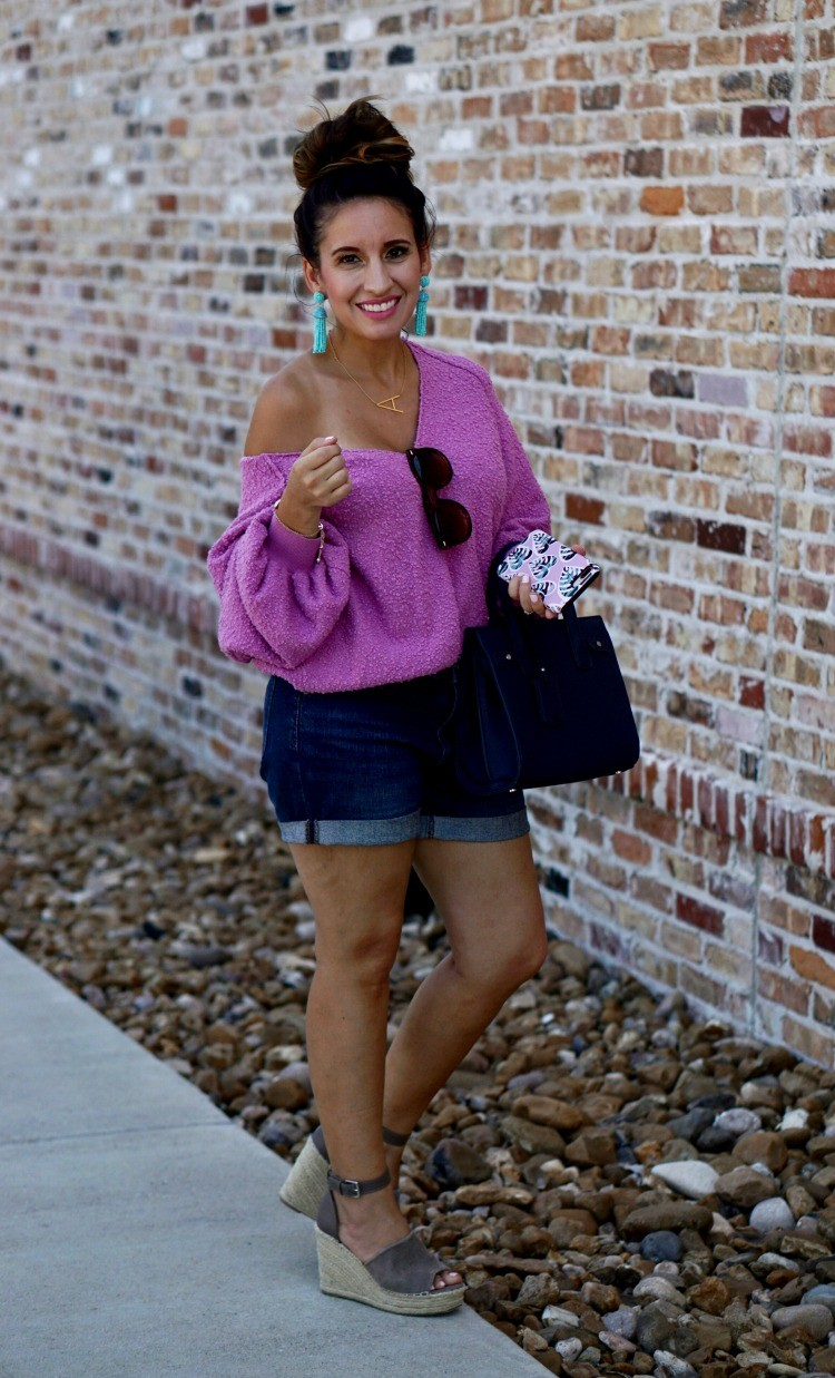 Statement earrings, slouchy drop shoulder sweater, shorts, and wedges