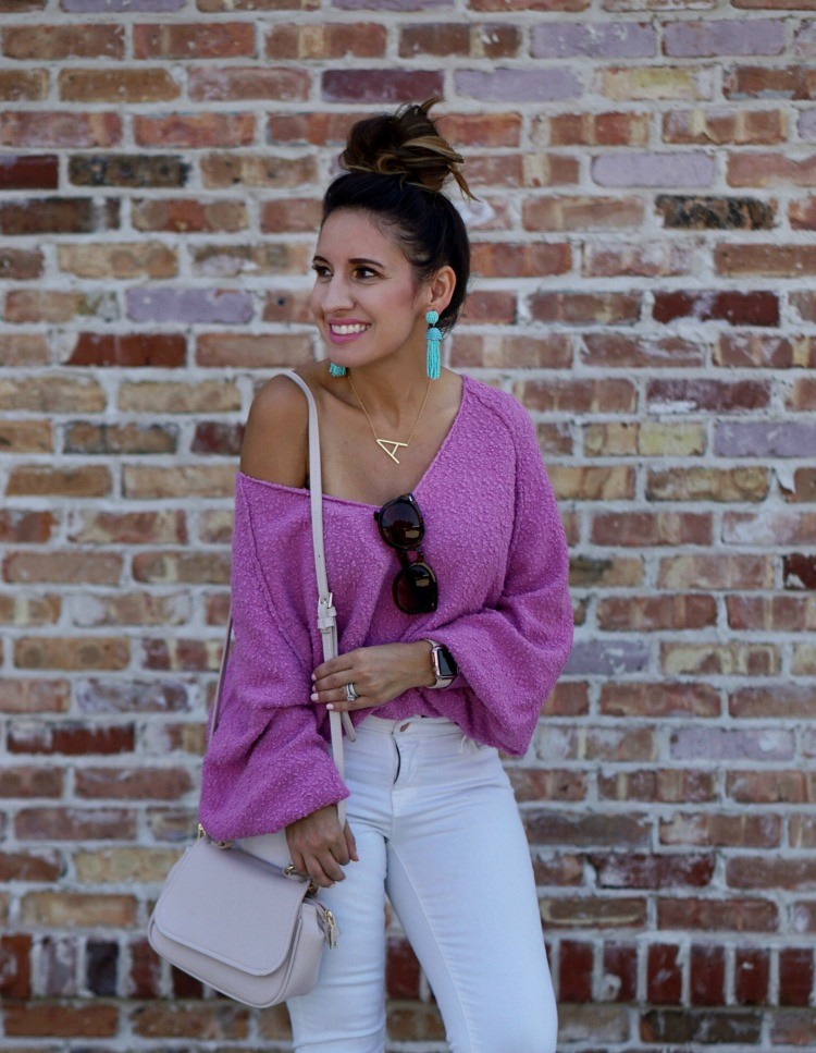 Topknot, Drop shoulder slouchy sweater, and statement earrings