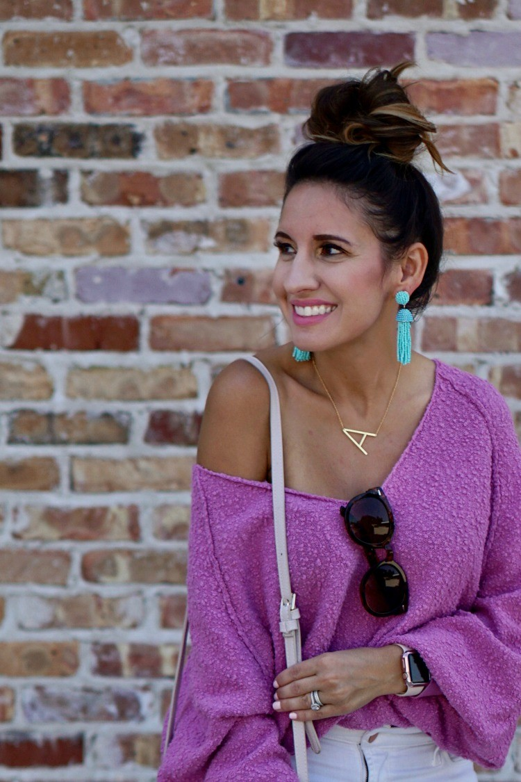 Topknot, turquoise statement earrings, and off the shoulder slouchy sweater