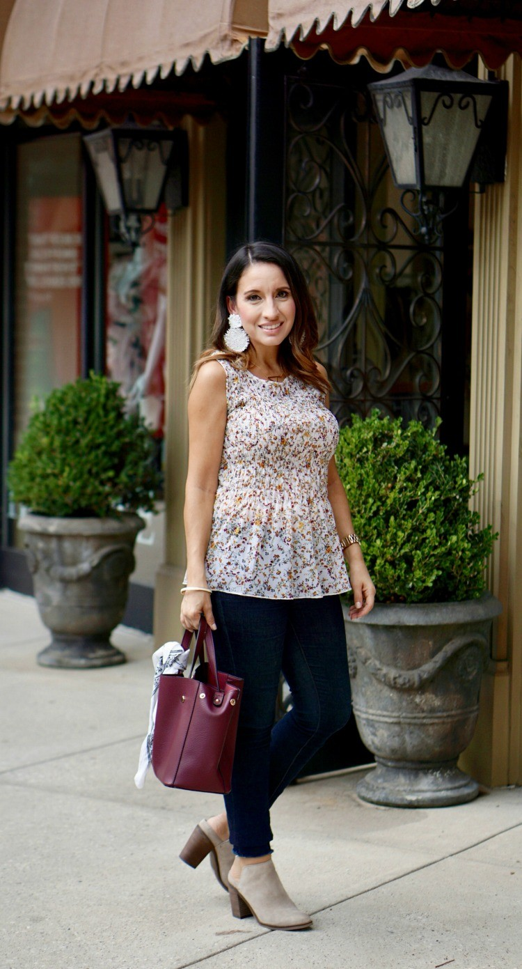 Floral smocked peplum top, dark jeans, and nude mules