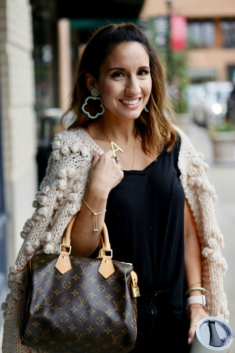 Turquoise Lisi Lerch earrings, monogram necklace, and chunky cardigan