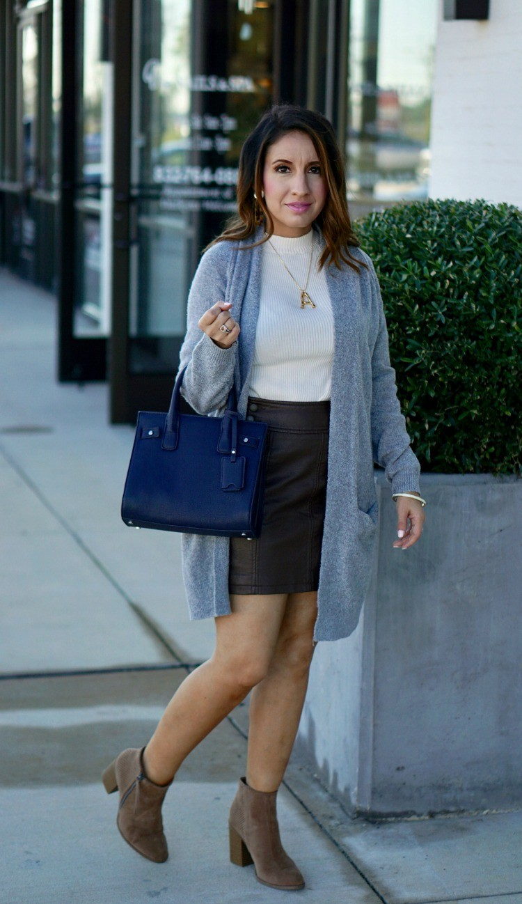 Grey cardigan, white sweater, leather skirt, and booties