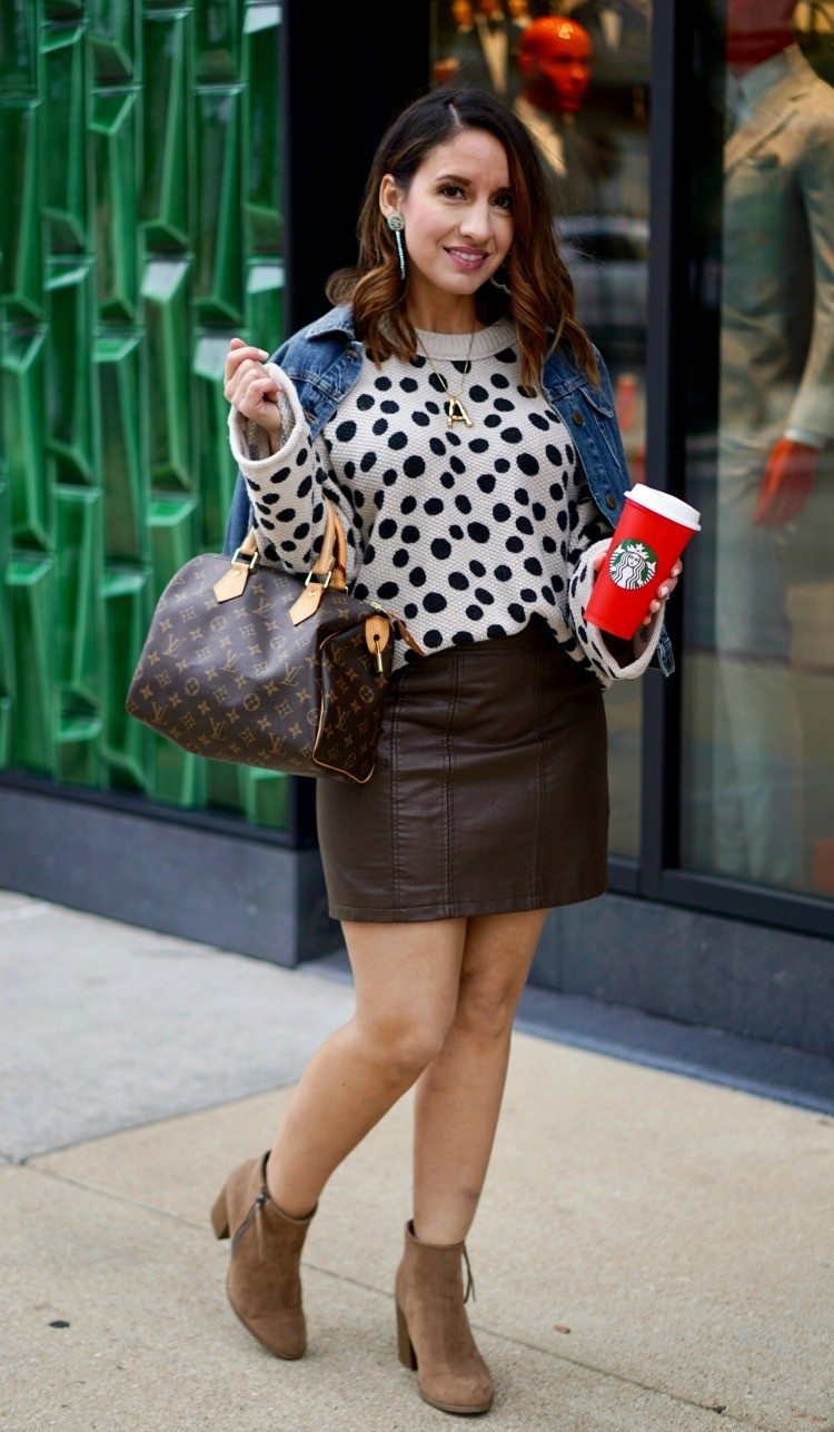 Jean jacket, leopard dot sweater, leather skirt, and booties