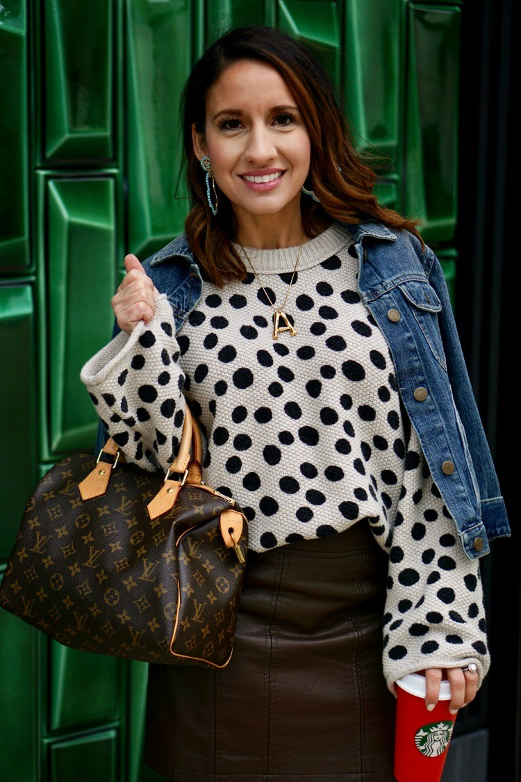 Lisi Lerch earrings, Love Always Couture necklace, leopard dot sweater, and leather skirt