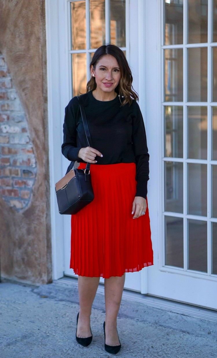 Ann Taylor black sweater, red skirt, and black heels