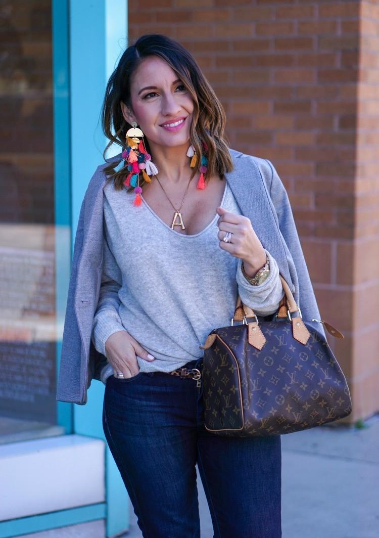 Bright bold statement earrings, grey blazer, v-neck knit top, and dark skinny jeans