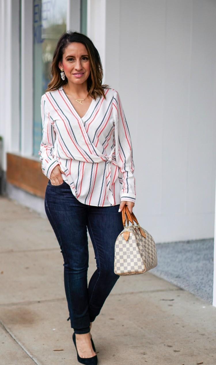 Faux wrap blouse, dark skinny jeans, black heels, and Louis Vuitton Handbag