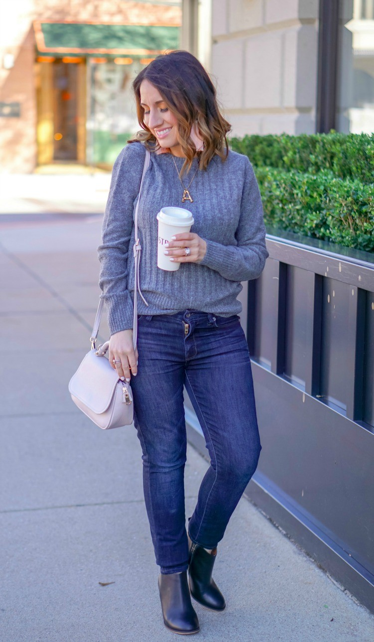 Grey ribbed sweater, skinny jeans, booties, and statement earrings