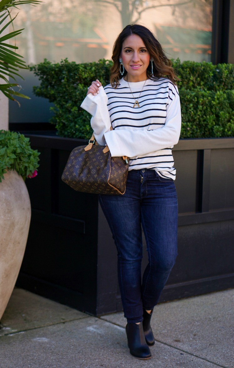 Striped bell sleeve top, dark skinny jeans, and black booties