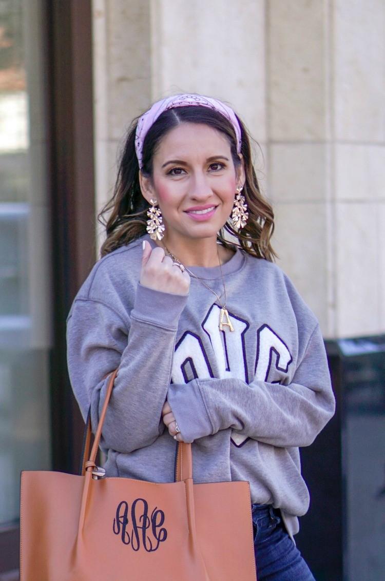 Grey monogrammed sweatshirt and statement earrings