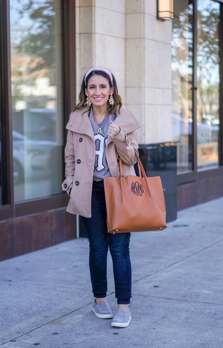 Monogrammed sweatshirt, dark skinnies, and brown handbag