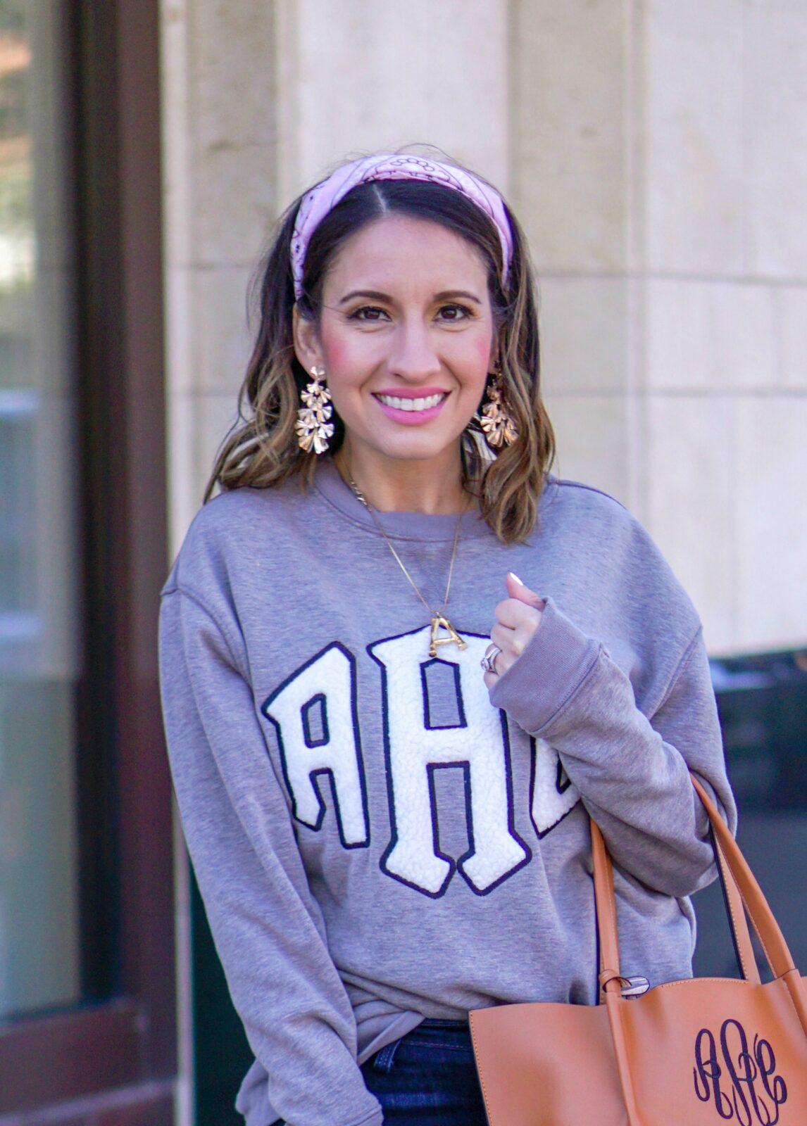 Pink Bandana, Grey monogrammed sweatshirt and brown handbag