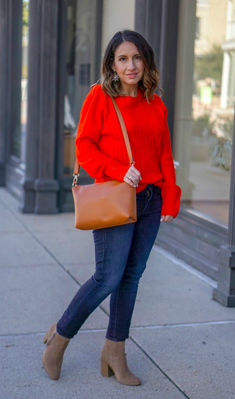 Red sweater, dark jeans and booties
