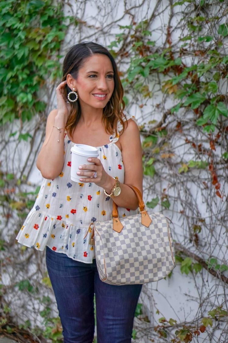Floral Peplum top, skinny jeans, Louis Vuitton Handbag and pearl hoop earrings